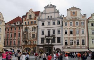 Pastel-colored buildings on the edge of the Old Town Square.