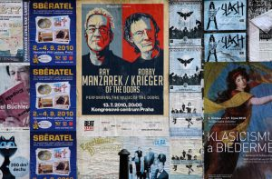 Posters on a street wall in Prague.