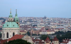 View of Prague with the dome and bell tower of St. Nicholas Church.