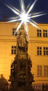 Statue of King Charles IV at night.