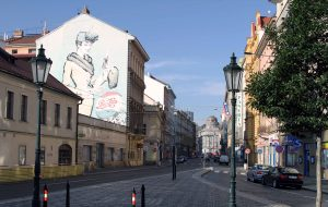 An advertisement for Pepsi painted on a side of a building along Jindřišská street in Prague.