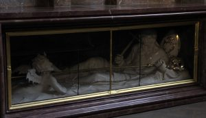 Sculpture of a bishop keeping a demon at bay (inside St. Nicholas Church).