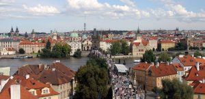 Charles Bridge covered in tourists, seen from the Little Quarter Bridge Tower.