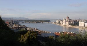 View of the Danube River with Margaret Island and the Hungarian Parliament Building.