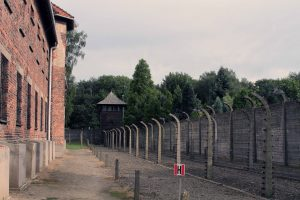 A tower and electric fences at Auschwitz I.