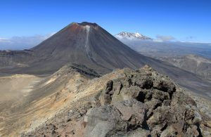 Standing on the western edge of South Crater with Mount Ngauruhoe and Mount Ruapehu in view.