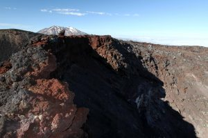 At the top of Mount Ngauruhoe with the crater and Mount Ruapehu visible.