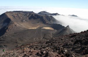 Looking down at South Crater from the top of Mount Ngauruhoe (notice the trail cutting right through the crater), with Blue Lake visible in the distance.