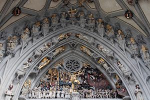 Ornate sculptures over the entrance to the Cathedral of Bern.