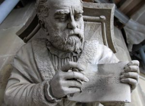 Sculpture of the architect, at the top of bell tower of the Cathedral of Bern.