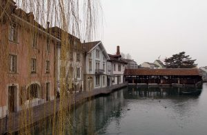 The Untere Schleuse - a covered wooden bridge over the Aare River in Thun.