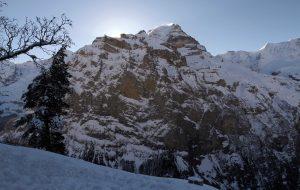 The sun behind Schwarzmönch mountain.