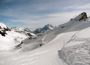 On a piste, ready to ski, with the Birg on the right.