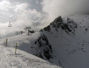 Looking back at the ski lift before continuing on down the piste.