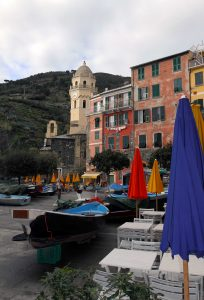 Boats propped up in Vernazza with the bell tower of Santa Margherita di Antiochia Church visible.