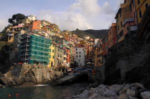 Riomaggiore, seen from the rocks by the sea.