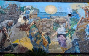 Wall painting next to the Riomaggiore train station that depicts the labor that went into building the terraced vineyards in Cinque Terre, as well as the work carried out during harvest.