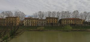 Buildings and trees across the Arno River.