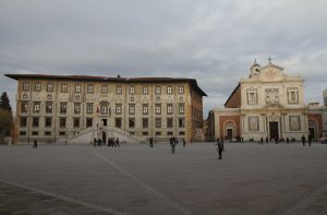 "Knight's Square (""Piazza dei Cavalieri"") with the Palazzo della Carovana (on the left) and the Church of the Knights of the Holy and Military Order of St. Stephen (on the right)."
