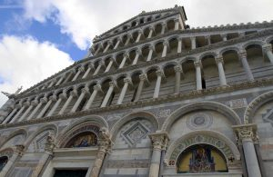 Looking up at the façade of the Pisa Cathedral.
