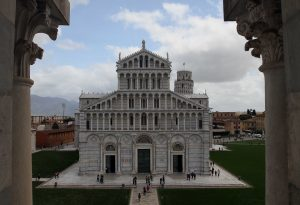 The façade of the Pisa Cathedral (with the top of the Leaning Tower visible behind it), seen from a window on the second level inside the Baptistry.