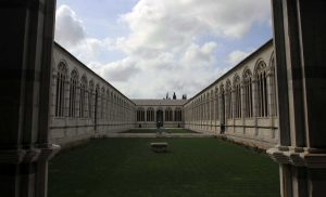 "The interior courtyard of the Camposanto Monumentale (""Monumental Cemetery""), a cemetery supposedly built around a shipload of sacred soil from Calvary, brought back to Pisa from the Fourth Crusade."