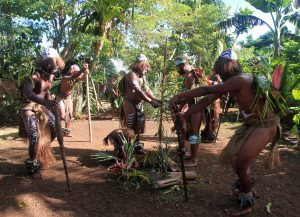 Men dancing at this cultural village.